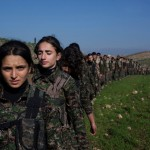 Young YPJ and YPG recruits participate in drills at the sniper training center in Saemalka, Al Hasakah, Syria on Dec. 21, 2014.