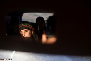 Vian, 16, who works in the media center, returns from covering a soldier graduation ceremony in Al-Malikiyah, Al Hasakah, Syria on Dec. 17, 2014.