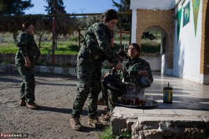 Young YPJ and YPG recruits pour cups of tea to share after a day of drills in Saemalka, Al Hasakah, Syria on Dec. 24, 2014.