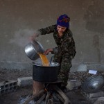 Young YPJ and YPG recruits prepare a meal after participating in drills near Saemalka, Al Hasakah, Syria on Dec. 24, 2014. The schedule is demanding and requires a great deal of discipline. New soldiers in training typically wake up at 4:00am with about 6 hours of sleep each night. Their days consist of a full schedule of drills and classroom lessons to be completed before joining the YPJ or YPG.