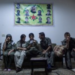 A group of snipers take a short break before returning to  the clashes between YPG, YPJ forces and ISIS on the Iraqi border, less than 100 meters away in Al-Ya'rubiyah, Al Hasakah, Syria on Sept. 28, 2014.