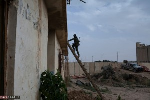 A concrete wall separates the YPG and YPJ forces from the clashing ISIS forces on the Iraqi border by less than 100 meters in Al-Ya'rubiyah, Al Hasakah, Syria on Sept. 28, 2014.