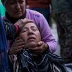 Family members mourn the death of a soldier killed by an IED at the press coverage of the liberation of Sinjar in Girê Sor, Al Hasakah, Syria on Dec. 22, 2014.