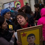 A young girl mourns the death of her older brother, a soldier killed by an IED at the press coverage of the liberation of Sinjar in Girê Sor, Al Hasakah, Syria on Dec. 22, 2014.