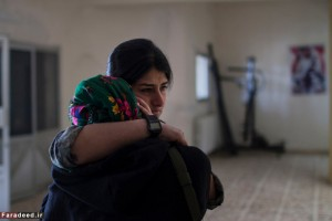 Friends and family mourn the death of a young soldier killed by an IED at the press coverage of the liberation of Sinjar in Girê Sor, Al Hasakah, Syria on Dec. 22, 2014.