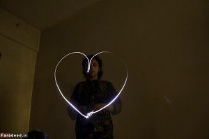 A female Kurdish fighter, creates a heart-shaped light painting as an expression of things she loves in Rmaylan, Al Hasakah, Syria on Dec. 19, 2014.
