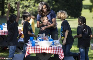 U.S. first lady Obama hugs elementary school students after picking vegetables with them during the annual fall harvest of the White House Kitchen Garden in Washington