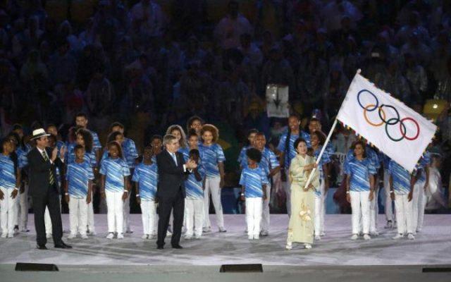 ۱۰۶۵۲۸۳۹۵_۲۰۱۶_Rio_Olympics_-_Closing_ceremony_-_Maracana_-_Rio_de_Janeiro_Brazil_-_21-08-2016_T-large_trans++Rf-JwjkUI04RQsPVbslsYE0dV2Q2bqCdKy92aRWqOus